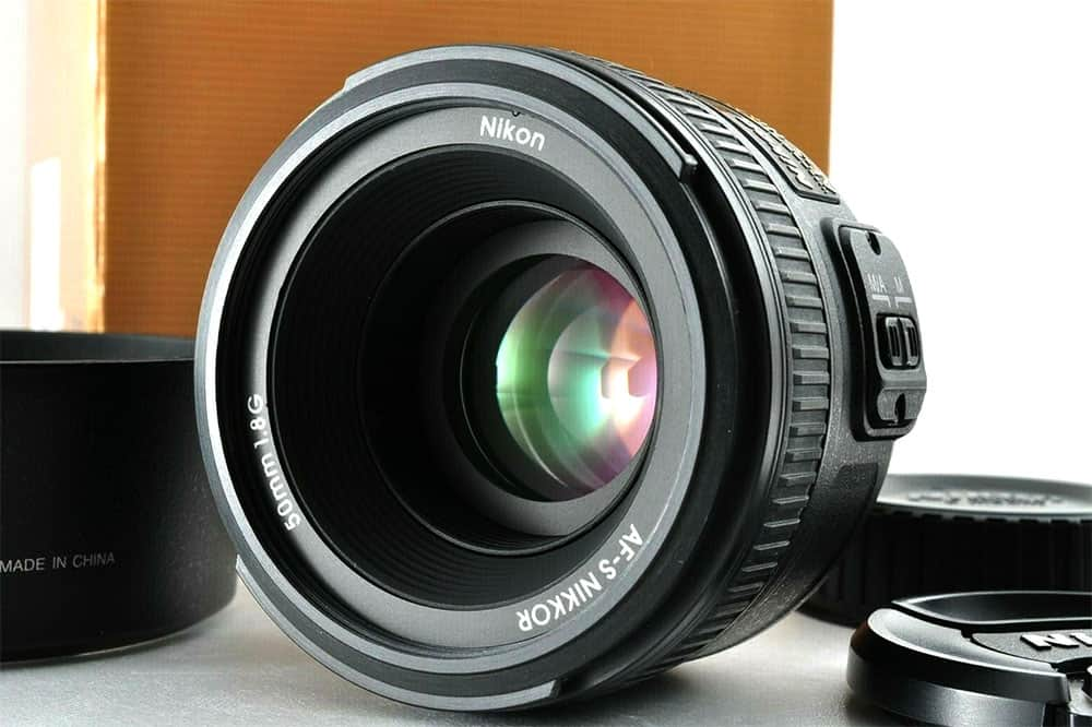 Nikon 50mm lens with cap and box
