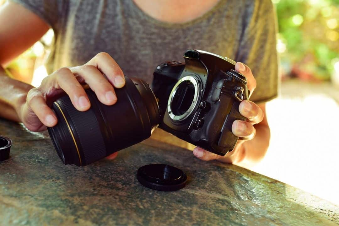 changing lens on a camera