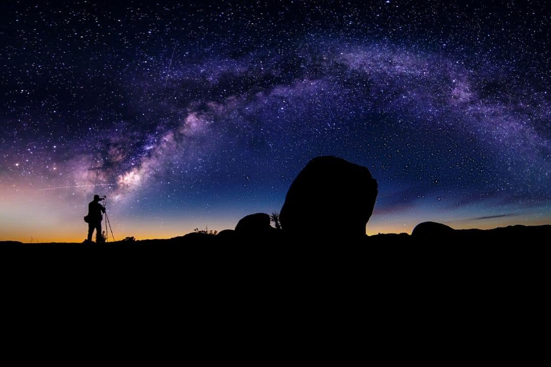 photographer and the milky way