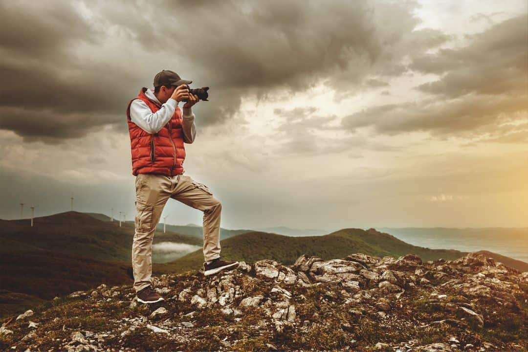 photographer posing in a valley during bad weather