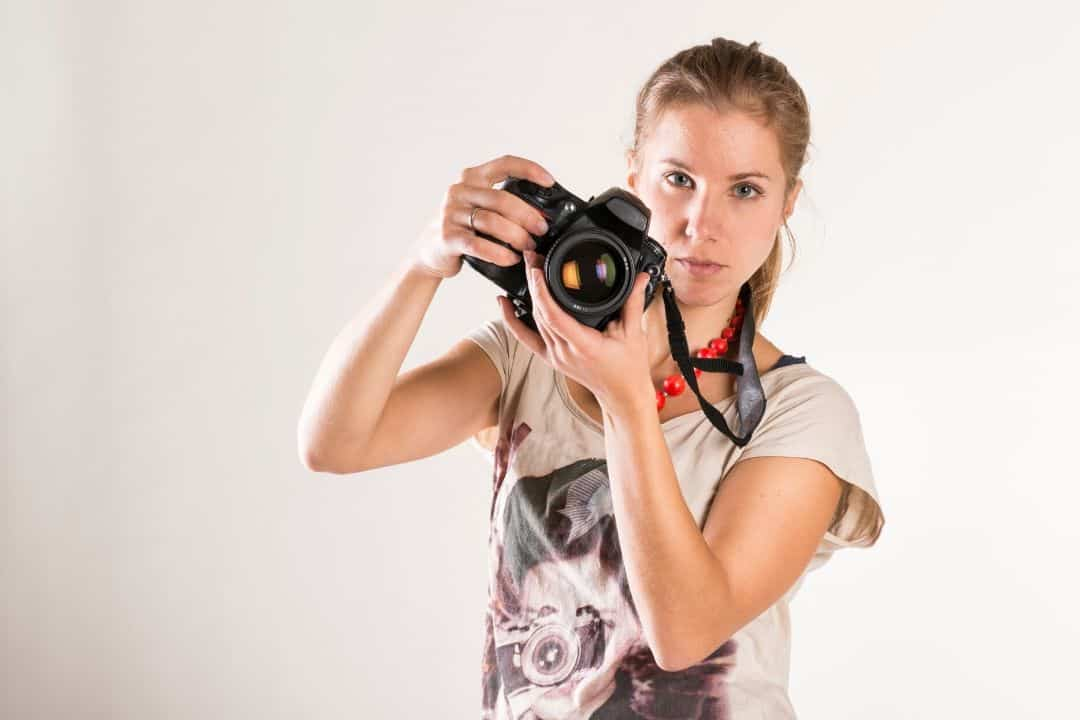 photographer holding a nikon camera