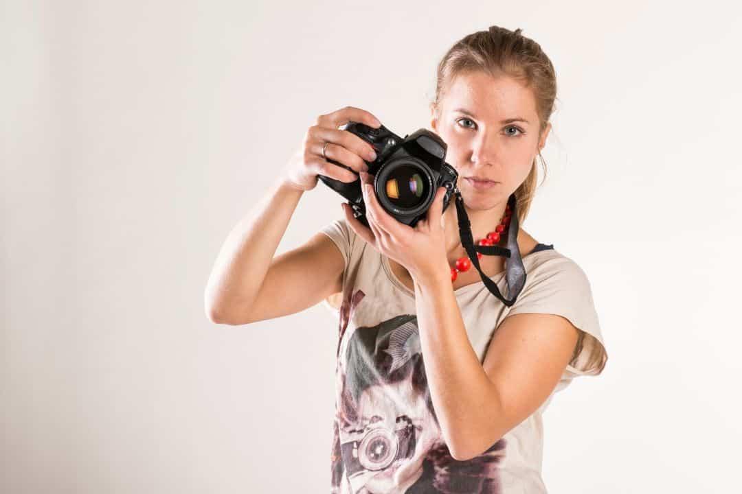 photographer holding a nikon camera