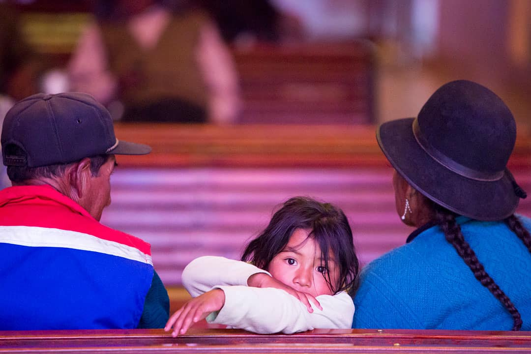 bolivian kid in church portrait