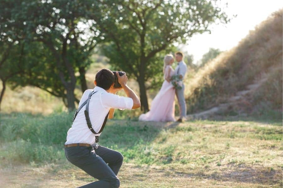 photographer shooting portraits of a married couple after the wedding
