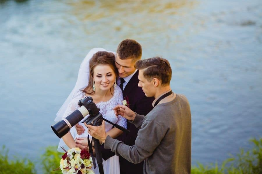 couple reviewing their marriage ceremony pictures on a canon camera