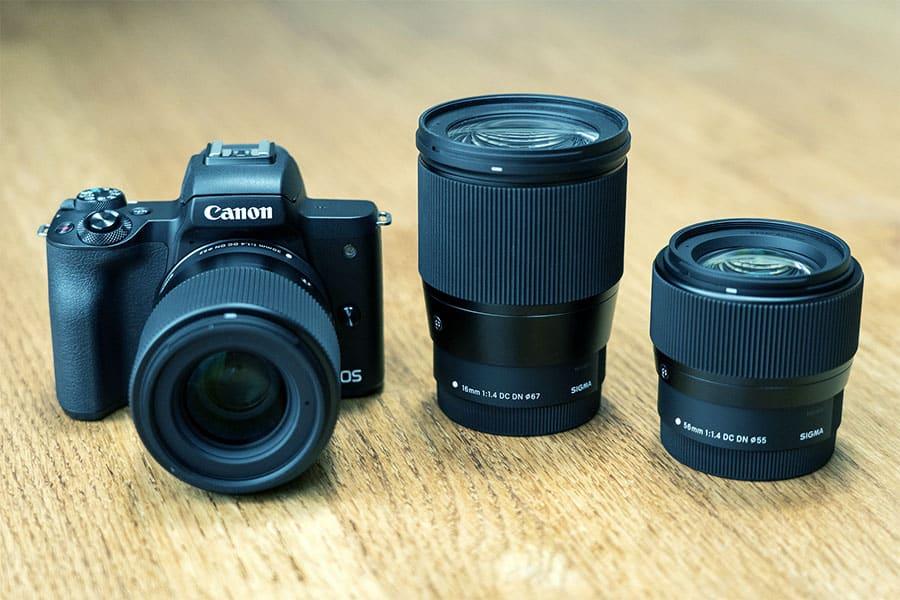sigma lenses next to the eos m camera