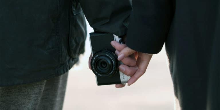 couple hand holding with a fuji x-e4 camera